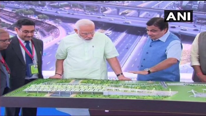 Prime Minister Narendra Modi inaugurates the first phase of Delhi-Meerut Expressway. Union Minister Nitin Gadkari also present. Image Courtesy: ANI/Twitter