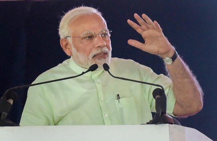 Prime Minister Narendra Modi addresses during the inauguration of 135km long Eastern Peripheral Expressway (NH-II) connecting Kundli to Palwal, at Bagpat, in Uttar Pradesh, on Sunday. PTI Photo