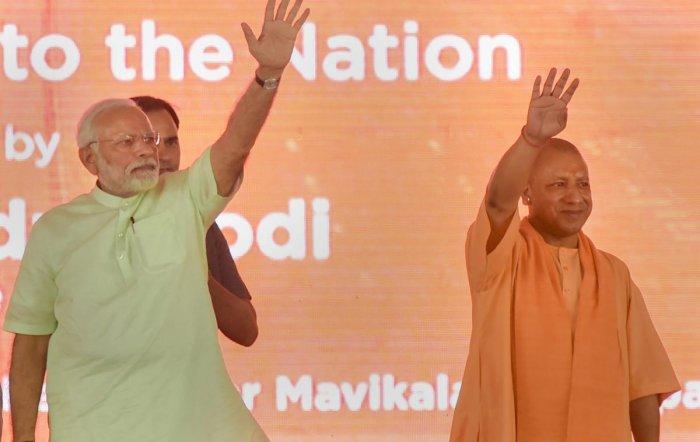 Prime Minister Narendra Modi with Uttar Pradesh Chief Minister Yogi Adityanath during the inauguration of 135km long Eastern Peripheral Expressway (NH-II) connecting Kundli to Palwal, at Bagpat, in Uttar Pradesh, on Sunday. PTI photo