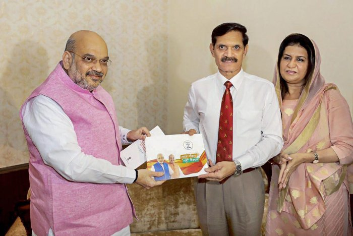 BJP president Amit Shah meets former army chief Gen Dalbir Singh Suhag during 'Sampark for Samarthan' campaign, in New Delhi on Tuesday. PTI