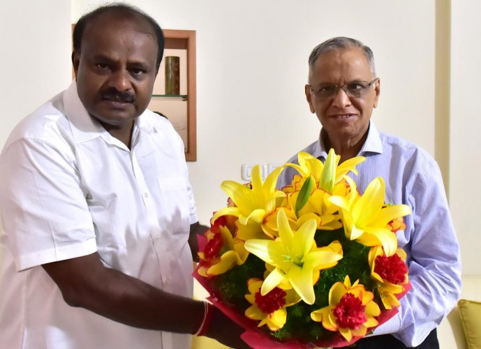 Chief Minister H D Kumaraswamy with Infosys founder N R Narayana Murthy on Friday. DH FILE