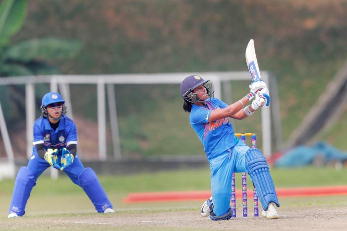 Indian cricketer Harman Kaur hits a boundary against Thailand during Asia Cup 2018, in Kuala Lumpur, Malaysia on Monday, June 04, 2018. (PTI Photo)