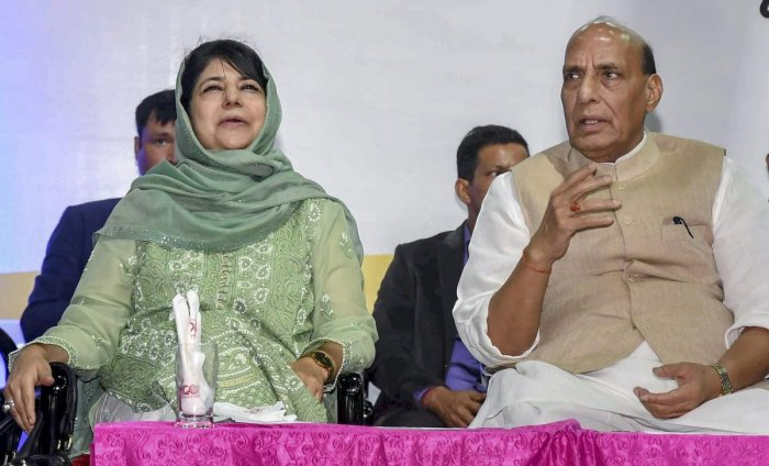 Union Home Minister Rajnath Singh with Jammu & Kashmir Chief Minister Mehbooba Mufti during 'Sports Conclave 2018', in Srinagar on Thursday. PTI Photo