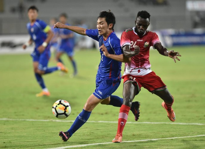 Keen tussle: Kenya's Vincent Wasambo (right) and Chinese Taipei's Chien-Ming Wang vie for the ball during their match in Mumbai on Friday. PTI