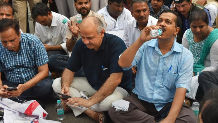 In this file photo dated May 14, 2018, Delhi Chief Minister Arvind Kejriwal with Deputy CM Manish Sisodia and party workers sit on a dharna outside Lieutenant-Governor Anil Baijal's House to discuss the acrimony over the issue of setting up of CCTV camera