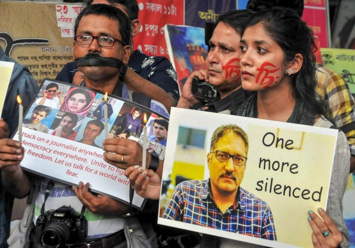Journalists take part in a silent protest to condemn the killing of veteran journalist Shujaat Bhukari, in Kolkata. PTI