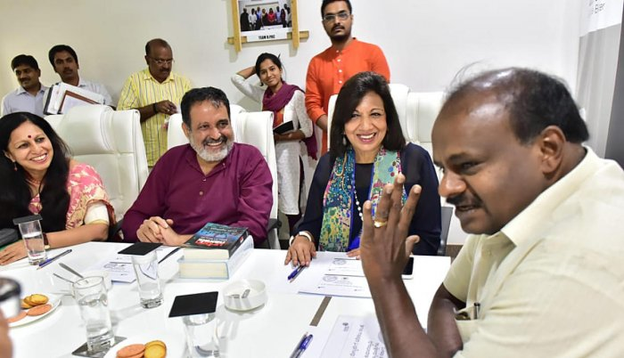 Chief Minister H D Kumaraswamy (right) with B.PAC members Kiran Mazumdar-Shaw and T V Mohandas Pai in Bengaluru in Saturday. DH photo