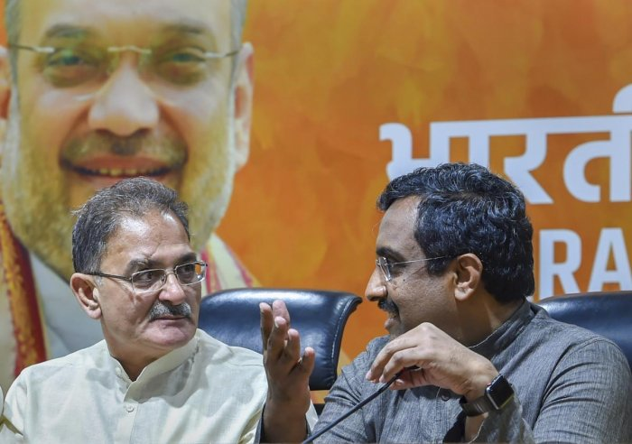 BJP in-charge for Jammu and Kashmir Ram Madhav with the former Dy Chief Minister Kavinder Gupta. PTI file photo