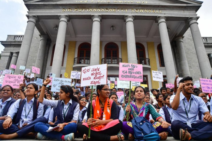 Students hold a protest at Town Hall on Tuesday against the government's decision to allow private agricultural colleges.