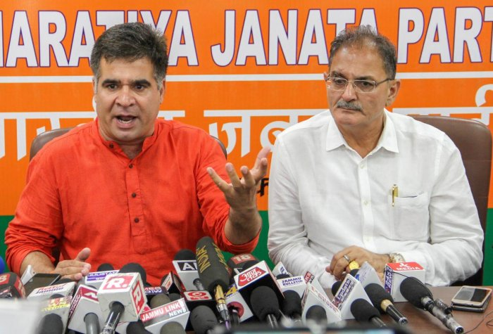 BJP State President Ravinder Raina (L) with former J & K dy chief minister Kavinder Gupta addresses a press conference, in Jammu on Wednesday. PTI Photo