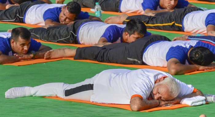 Prime Minister Narendra Modi performs yoga during a mass yoga event on 4th International Yoga Day at Forest Research Institute (FRI) ground in Dehradun, on Thursday. PTI file photo