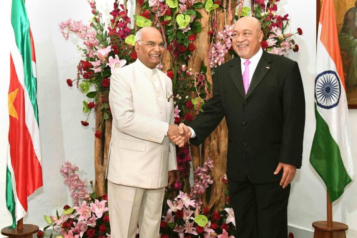 President Ram Nath Kovind shakes hands with his Surinamese counterpart Desire Delano Bouterse ahead of delegation-level meeting, in Suriname on Thursday, June 21, 2018.