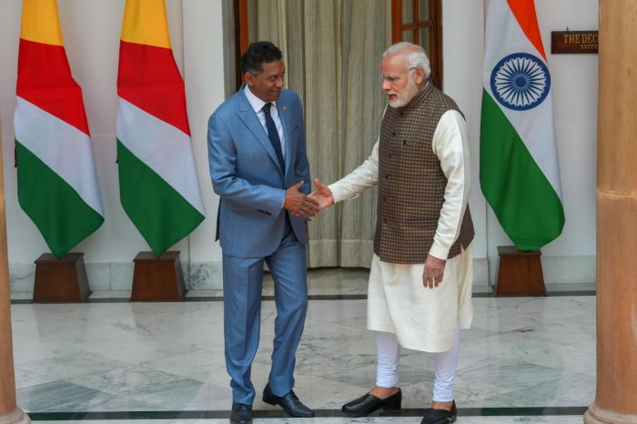 Prime Minister Narendra Modi shakes hands with Seychelles President Danny Antoine Rollen Faure ahead of a meeting at Hyderabad House, in New Delhi on Monday. (PTI Photo)