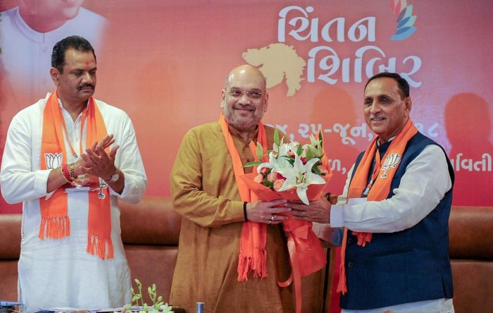 BJP president Amit Shah being greeted by Gujarat Chief Minister Vijay Rupani during the second day of the party's two-day 'Chintan Shivir', in Ahmedabad on Monday. PTI
