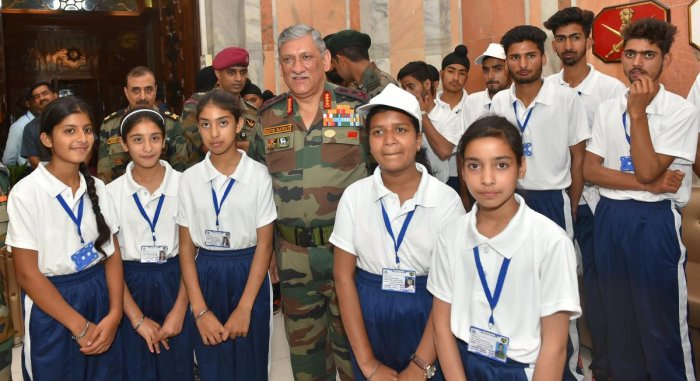 Chief of Army Staff, General Bipin Rawat poses with students from Jammu and Kashmir on National Integration/Educational Tour organised by the Army, in New Delhi on Friday. (PTI Photo)