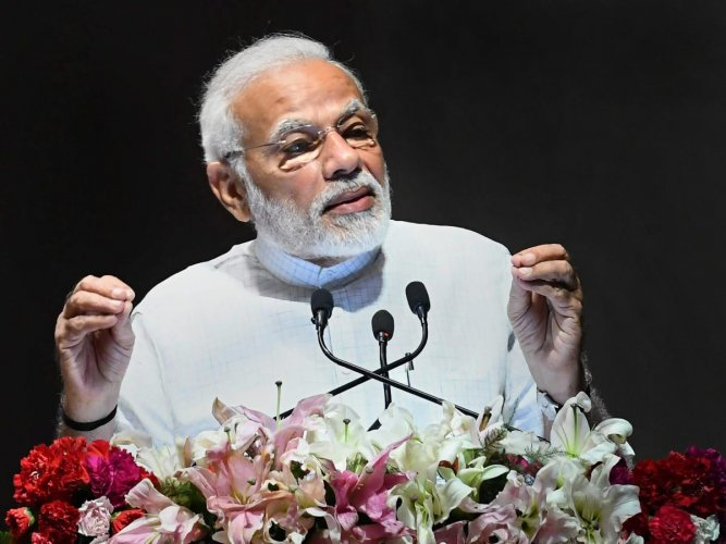 Prime Minister Narendra Modi addresses the gathering after the launch of various healthcare projects, at AIIMS, in New Delhi on Friday. PTI