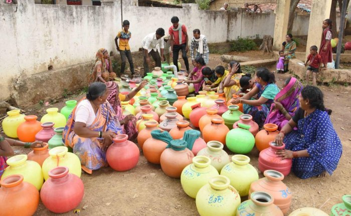 Fetching water is still a Herculean task for people in several villages. The universal drinking water scheme will require creation of infrastructure to connect water sources to the villages. dh file photo