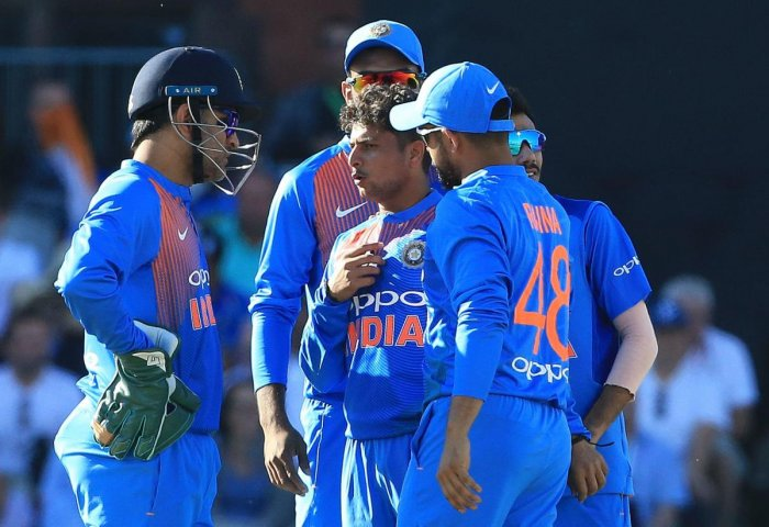 TIMELY JOLT India's Kuldeep Yadav (centre) will be keen to bounce back in the decider after an ordinary show in the second T20I. AFP