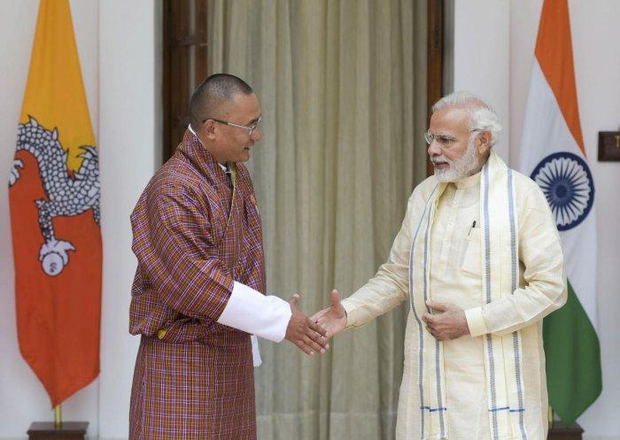 New Delhi: Prime Minister Narendra Modi and Bhutanese Prime Minster Dasho Tshering Tobgay before their meeting at Hyderabad House, in New Delhi on Friday, July 6, 2018.(PTI Photo/Vijay Verma)