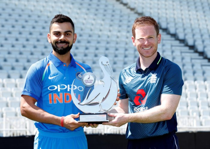 Virat Kohli and Eoin Morgan pose with the trophy. (Reuters Photo)