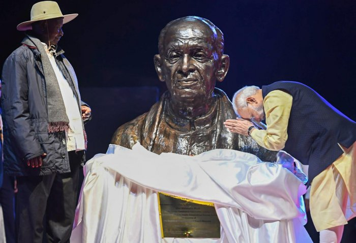 Prime Minister Narendra Modi pays tribute to India's first home minister Sardar Vallabhbhai Patel after unveiling his bust along with Ugandan President Yoweri Museveni (L) at an Indian community event in Kampala, Uganda. PTI Photo