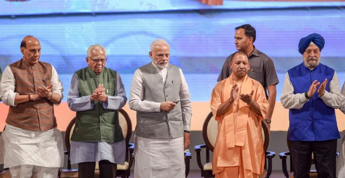 Prime Minister Narendra Modi with Uttar Pradesh Governor Ram Naik, Chief Minister Yogi Adityanath and Union Home Minister Rajnath Singh inaugurate various projects, in Lucknow on Saturday. PTI