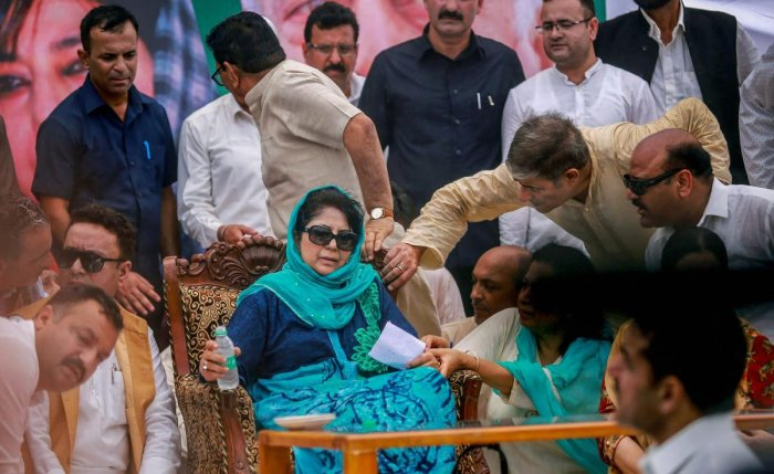 Jammu: PDP President and former chief minister Mehbooba Mufti being offered water after she complained of uneasiness while addressing a public rally on the 19th Foundation Day of the party in Jammu on Monday, July 30, 2018. (PTI Photo)(PTI7_30_2018_000112
