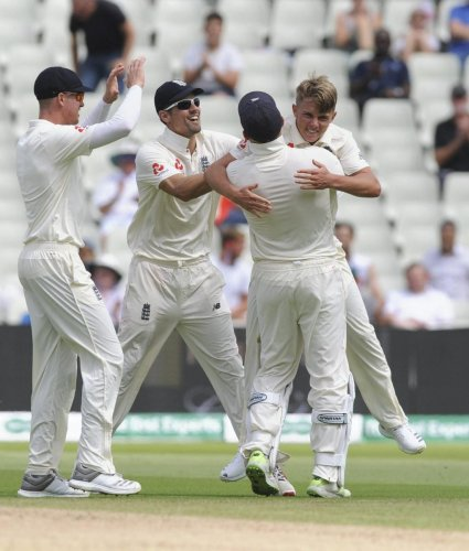 England's Sam Curran (right) celebrates with team-mates after dismissing India's K L Rahul on the second day of the first Test cricket at Edgbaston on Thursday. AP-PTI