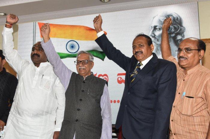 Shashank Raj, film director, V Lokesh Gowda, President, Rashtrageete Jagruthi Abiyana Samitte, Doddarangegowda, Litterateur, SB Chabbi Retd ACP and Lakshmi Srinivas, writer are seen at the press meet regarding National Anthem awareness programme held on 1