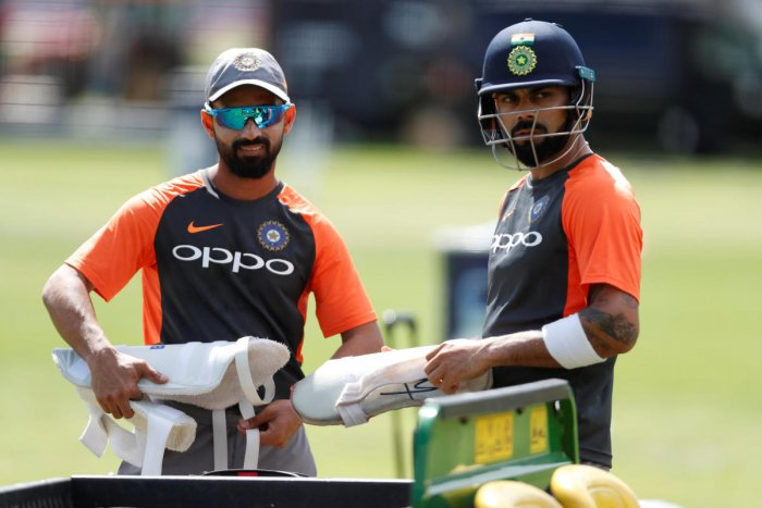 TIME TO PONDER: Skipper Virat Kohli (right) and his deputy Ajinkya Rahane during India's practice session at Lord's on Wednesday. Reuters