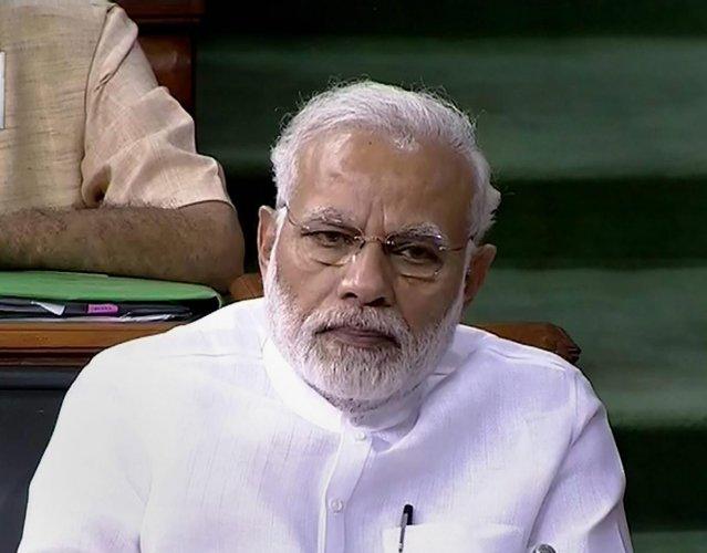 New Delhi: Prime Minister Narendra Modi in the Lok Sabha on the last day of the Monsoon session of Parliament, in New Delhi on Friday, Aug 10, 2018. (LSTV GRAB via PTI) (PTI8_10_2018_000123B)
