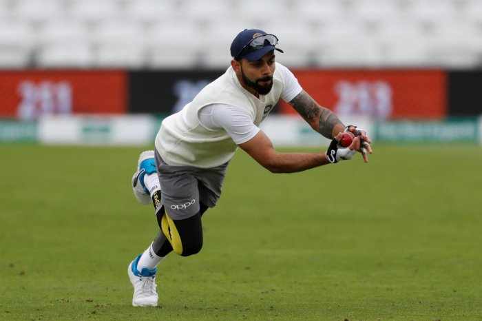 TOUGH NUT: Skipper Virat Kohli appeared in no visible discomfort during India's practice session on Friday. Reuters