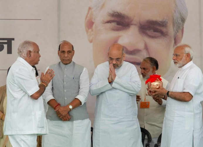 Prime Minister Narendra Modi hands over the ashes ('Asthi Kalash') of former prime minister Atal Bihari Vajpayee to Karnataka BJP President for immersion in his state, at the party headquarters in New Delhi on Wednesday. PTI