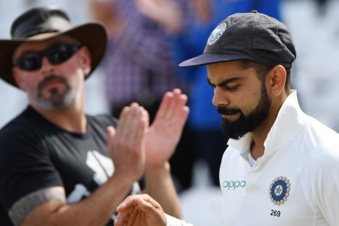 India's captain Virat Kohli is applauded as he leaves the field after winning the third Test cricket match between England and India at Trent Bridge in Nottingham, central England on Tuesday. AFP