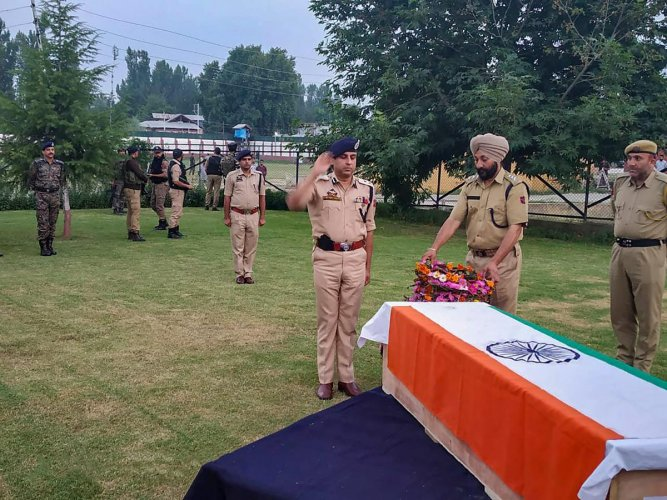 Inspector General of Police (Kashmir) S P Pani attending funeral of JK policeman Mohd Yaqoob Shah, who was gunned down in Pulwama on Wednesday, August 22, 2018. (PTI Photo)