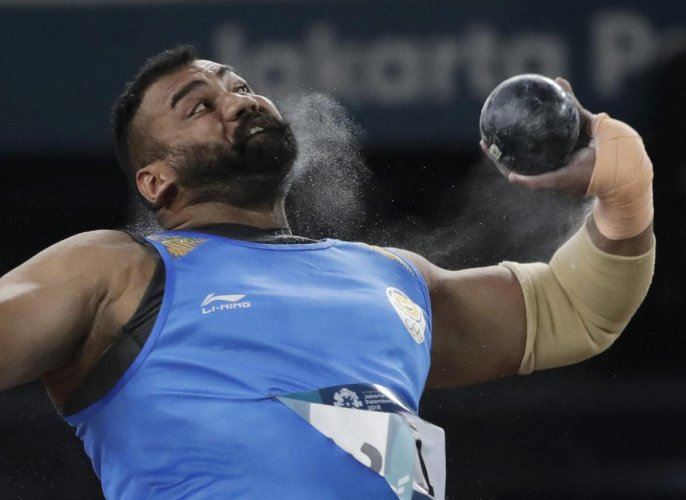 India's Tajinderpal Singh Toor en route to his men's shot put gold at the Asian Games in Jakarta on Saturday, AP/ PTI