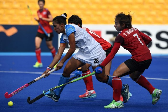 NIMBLE Indian skipper Rani Rampal (centre) dribbles past Thailand's defenders during their clash in Jakarta on Monday. AFP