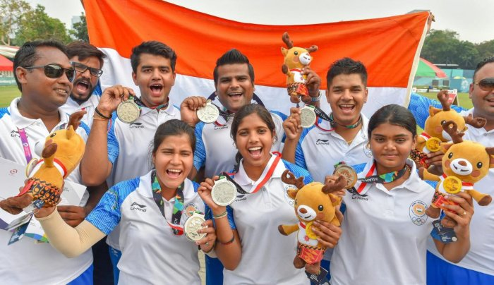 CHEERFUL Indian men's and women's archery team members celebrate with their silver medals in Jakarta on Tuesday. PTI