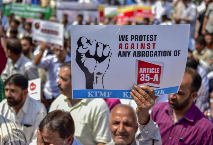 Kashmir traders raise slogans during a protest march against the petitions in the Supreme court challenging the validity of Article 35A, in Srinagar on Wednesday. PTI