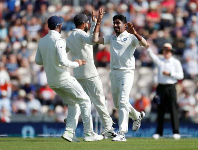 ON FIRE: India's Jasprit Bumrah (right) celebrates with team-mates after dismissing England opener Keaton Jennings on the opening day of the fourth Test at Southampton on Thursday. AFP