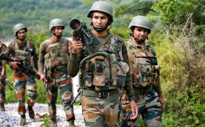 Army personnel carry out a search operation after militants attacked a CRPF party at Jahjar Kotli on Srinagar-Jammu National highway, 35 kms away from Jammu, on Wednesday. (PTI Photo)
