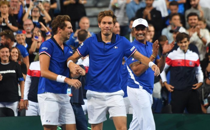 DONE AND DUSTED: France's Nicolas Mahut (centre) and team-mate Julien Benneteau (left) celebrate with team captain Yannick Noah after their doubles win against Spain that helped them take an unbeatable 3-0 lead, on Saturday. AFP
