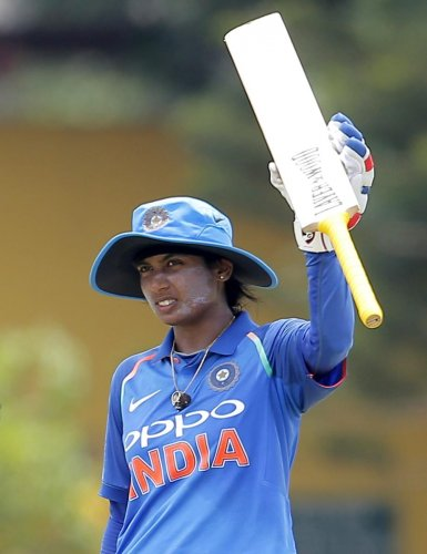 India's Mithali Raj celebrates after scoring a half century against Sri Lanka on Sunday. AP/PTI