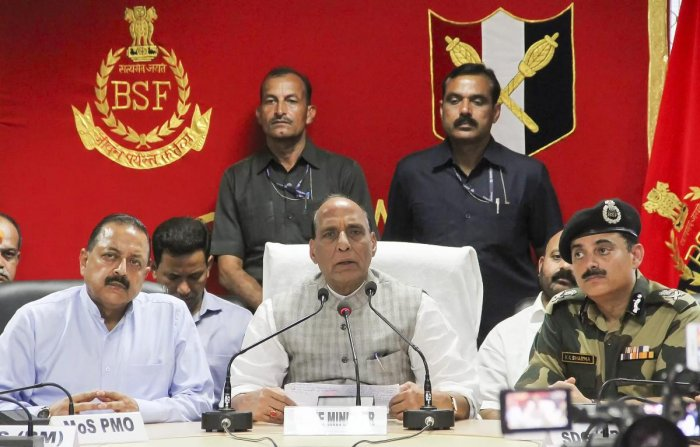 Home Minister Rajnath Singh (C) addresses the media as Mos for PMO Jitendra Singh (L) and DG BSF K K Sharma (R) look on, after the inauguration the first 'Smart Fence' pilot project along the Indo-Pak Border, in Jammu on Monday. (PTI Photo)