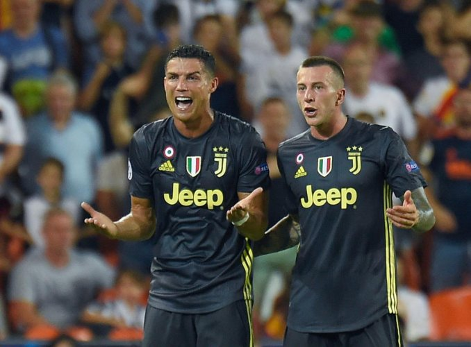 Cristiano Ronaldo (left) of Juventus is aghast after being shown the red card in the game against Valencia.