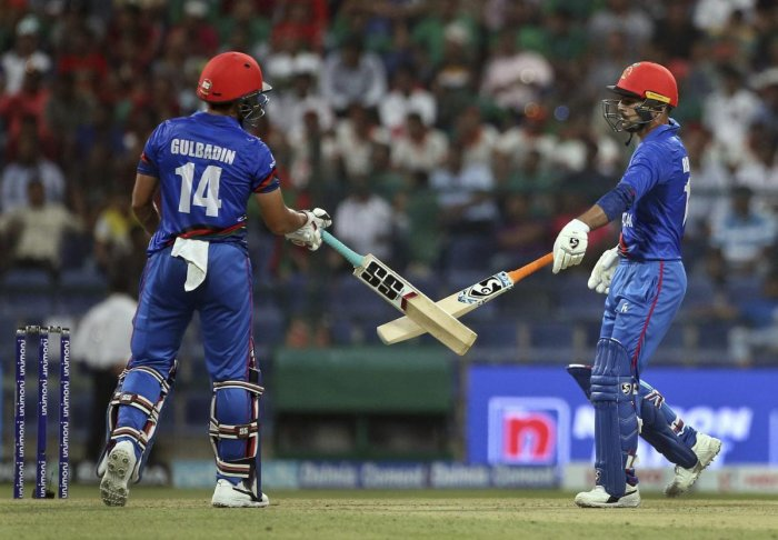 Afghanistan's Gulbadin Naib, left, and Rashid Khan cheer each other by touching the bats during the one-day international cricket match of Asia Cup between Bangladesh and Afghanistan in Abu Dhabi, United Arab Emirates, Thursday, Sept. 20, 2018. (AP/ PTI)