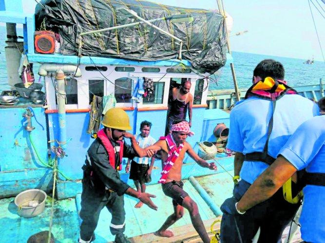 ICG personnel rescue fishermen.