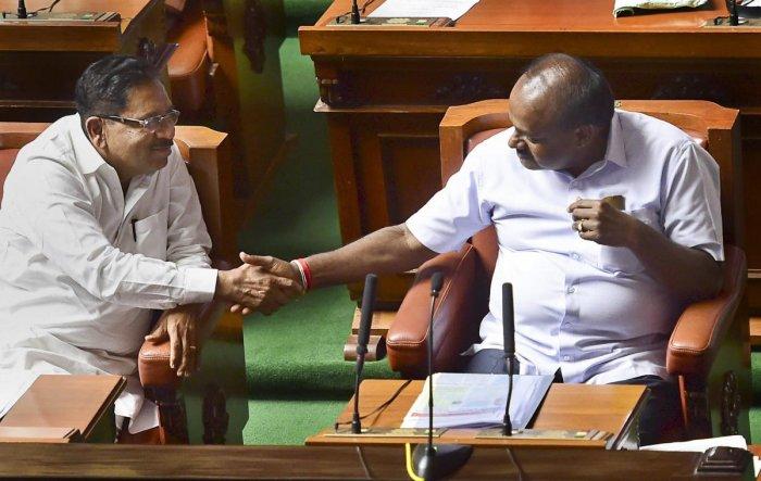Karnataka chief minister H D Kumaraswamy and his deputy G Parameshwara in the Legislative Assembly. (PTI file photo)