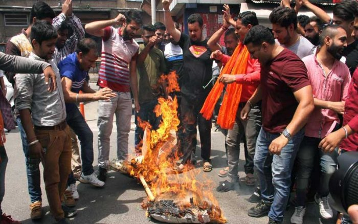 Bajrang Dal activists burn an effigy of Jammu and Kashmir Chief Minister Mehbooba Mufti during a protest demanding a CBI probe in the rape and murder of the 8-year-old Kathua girl, in Jammu on Saturday. PTI Photo