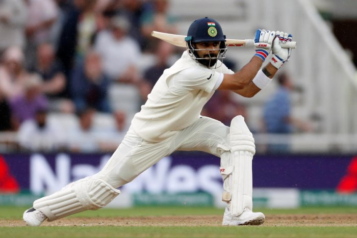 STYLISH: Indian skipper Virat Kohli drives one to the fence on the third day of the third Test against England in Nottingham on Monday. Reuters